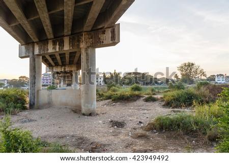Under Concrete Bridge in The Boarder Between Thailand and Myanmar - stock photo