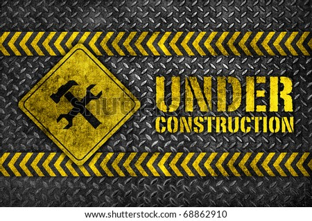 under construction hammer and wrench metal sign - stock photo