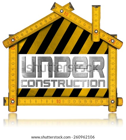 Under Construction - House Project Concept. Wooden meter ruler in the shape of house with text under construction. Isolated on white background  - stock photo