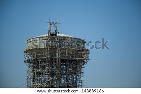 Under construction of reserve water supply Tank under blue sky - stock photo