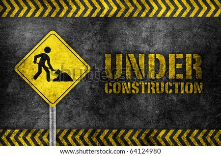 under construction pole sign in dark style - stock photo