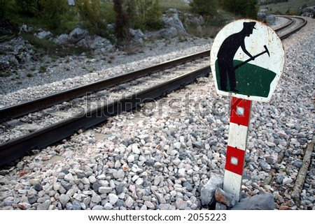 Under construction sign at the railroad - stock photo