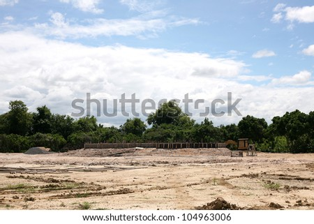 Under construction site with blue sky background - stock photo