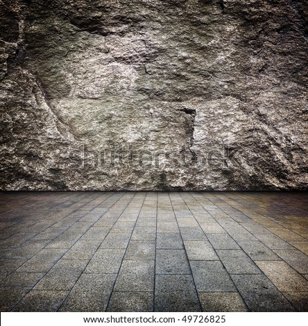 Under ground chamber with natural rock wall - stock photo