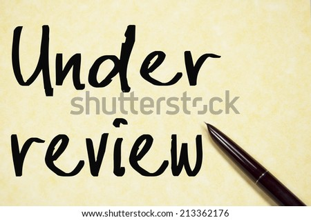 under review text write on paper  - stock photo