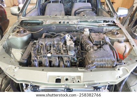 Under the hood of the car. Car is prepared for repair - stock photo