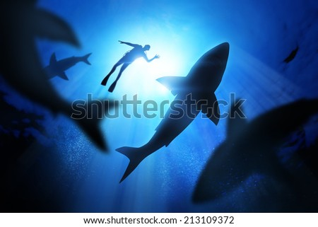 Under the waves a diver with great white sharks. - stock photo