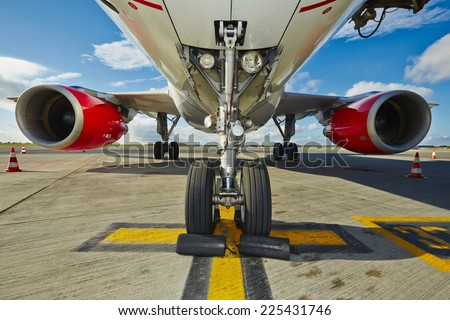 Undercarriage of the aircraft at the airport. - stock photo