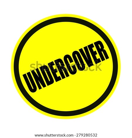 UNDERCOVER black stamp text on yellow