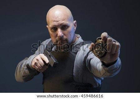 Undercover Law Enforcement Special Agent with gun and badge. - stock photo