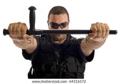 Undercover policeman with a rough look, holding a baton tonfa with both hands - stock photo