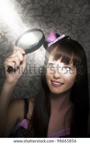 Undercover Spy Looking To The Light Through A Magnifying Glass For A Clue To Answer The Question To An Unsolved Crime In Murder Mystery Concept - stock photo