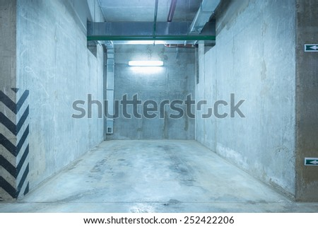 Underground city parking for the private car under the skyscraper. - stock photo