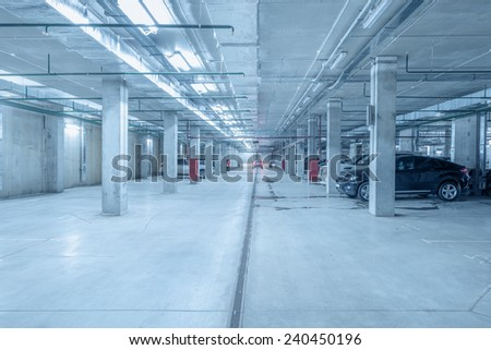 Underground city parking for the private cars under the skyscraper. - stock photo