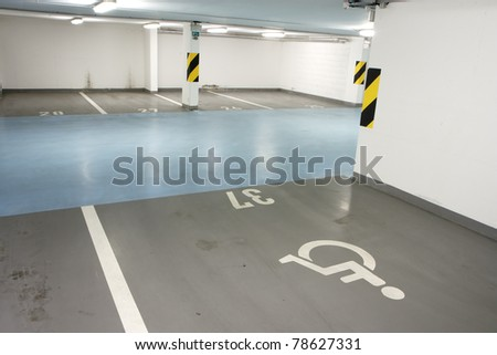 Underground garage - parking lot in a basement of house for disabled person - stock photo