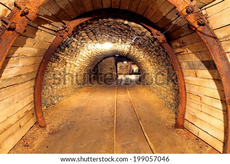 Underground mine tunnel, mining industry - stock photo