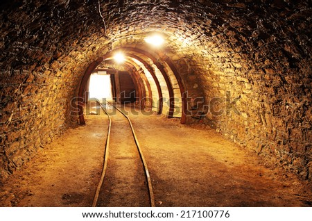 Underground mine tunnel, mining industry - stock photo