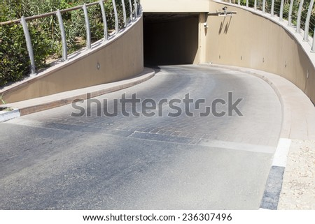 underground parking entrance - stock photo