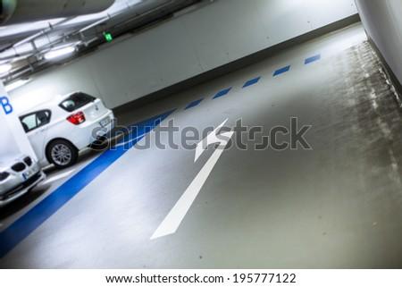 Underground parking/garage (color toned image; shallow DOF) - stock photo