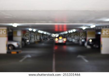 underground parking garage with a few cars(blur background) - stock photo