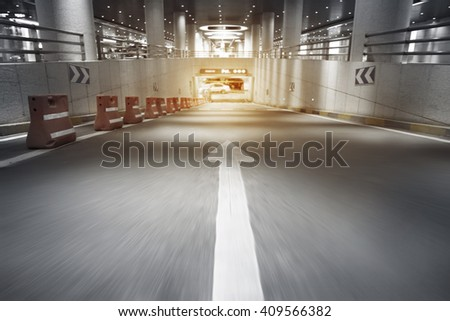 Underground parking lot arrow sign   - stock photo