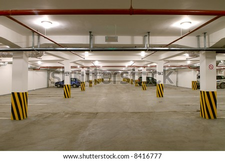 Underground parking on a plenty of machines - stock photo