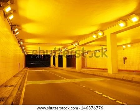 underground passage at yellow streetlight - stock photo