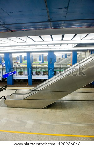underground railway station, escalators