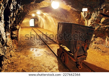 Underground train in mine, carts in gold, silver and copper mine. - stock photo