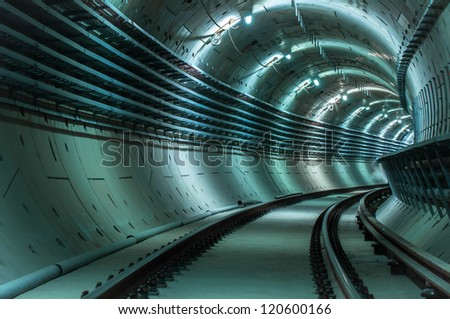 Underground tunnel with blue lights angle shot - stock photo