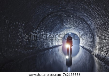 Underground tunnel with river and canalization