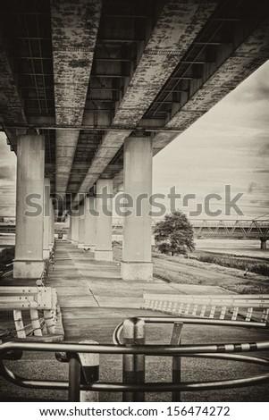 Underneath of freeway bridge - stock photo