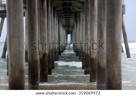 Underneath the Huntington Beach Pier in Southern California during the El Nino of 2016 - stock photo