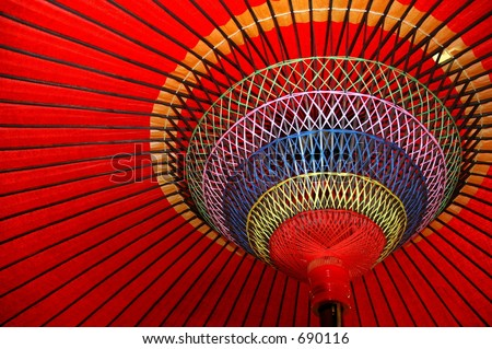 Underneath the Red Japanese Umbrella - stock photo