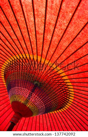 Underside of red japanese parasol - stock photo