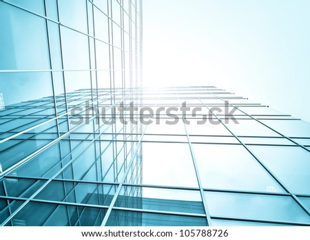 underside view to steel glass high-rise building - stock photo