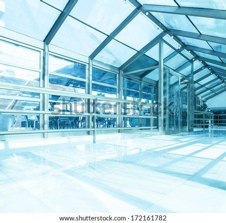 Underside wide angled and perspective view to steel blue glass airport ...