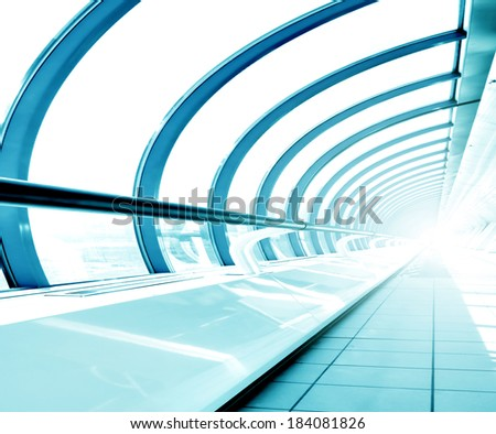 Underside wide angled and perspective view to steel blue glass airport ceiling through high rise building skyscrapers, business concept of successful industrial hallway and passageway architecture - stock photo