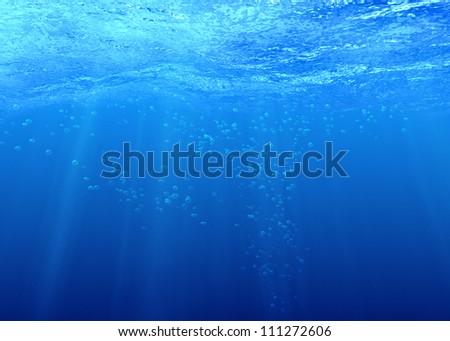 Underwater background with bubbles in sea water - stock photo