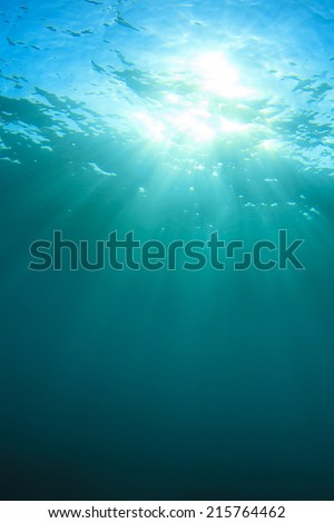 Underwater background with sun - stock photo