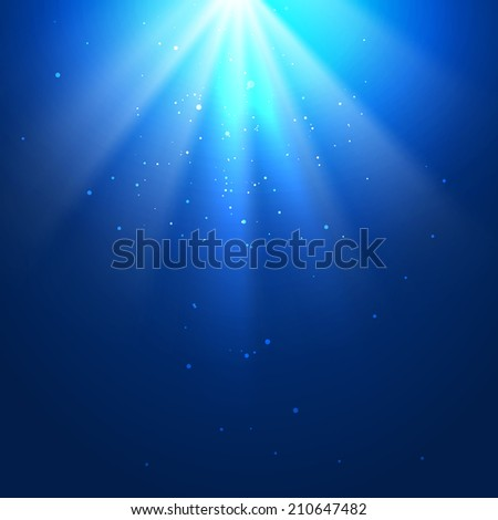 Underwater blue background with sun rays  - stock photo