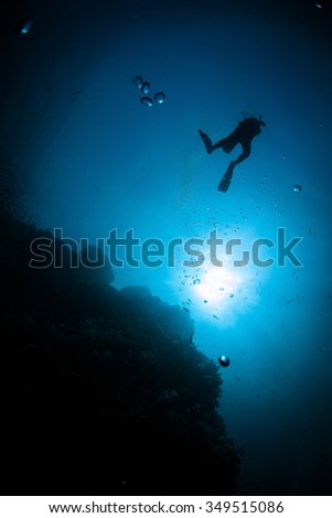 Underwater Blue Sea and scuba diver  - stock photo