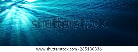 underwater - blue shining in deep of the sea - stock photo