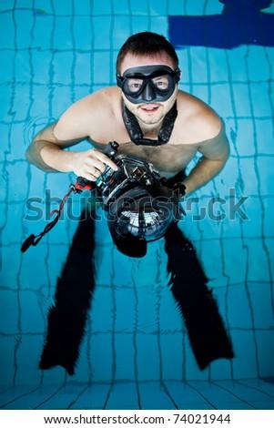 Underwater camera operator - stock photo