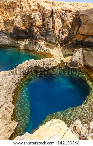 underwater cave in the form of heart at Azure Window in Gozo, Malta - stock photo