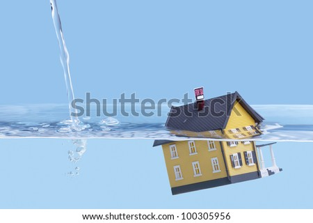 Underwater home mortgage, house for sale, real estate crisis concept, copy space - stock photo