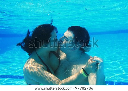 Underwater kiss of loving couple