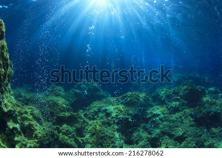 Underwater ocean scene with air bubbles, unfocused - stock photo