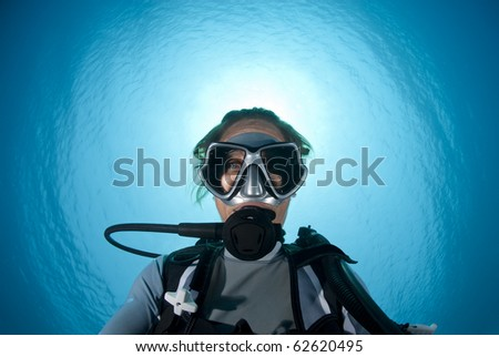 Underwater portrait of a woman scuba diving.  Shaab Ohrob, Southern Red Sea, Egypt. - stock photo