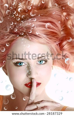 Underwater portrait of beautiful young woman with blue eyes - stock photo